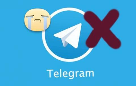 Immagine raffigurante l'icona di Telegram con una croce ed una faccina che piange